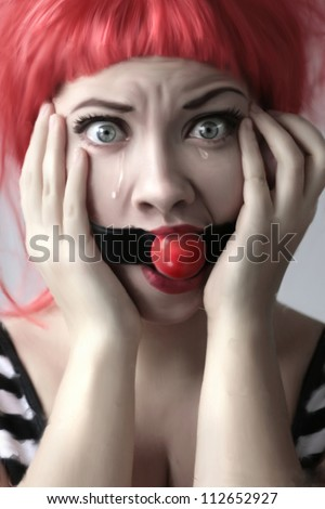 Surprised girl with a gag - stock photo