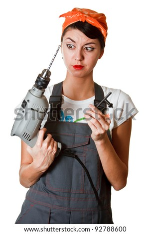 Surprised girl with tools isolated on white background - stock photo
