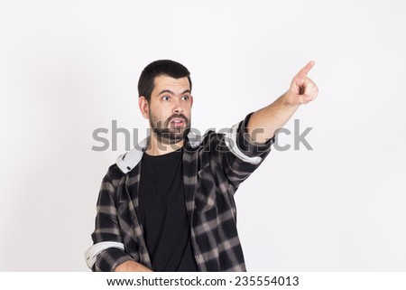 Surprised guy pointing a place - stock photo