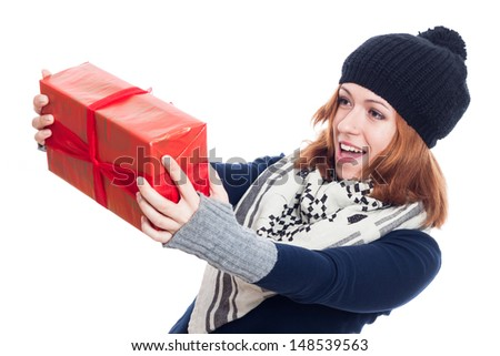 Surprised happy woman in winter clothes holding present, isolated on white background. - stock photo