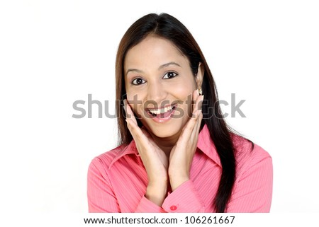 Surprised Indian business woman against white background - stock photo