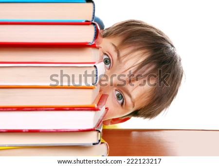 Surprised Kid behind the Books Isolated on the White Background - stock photo