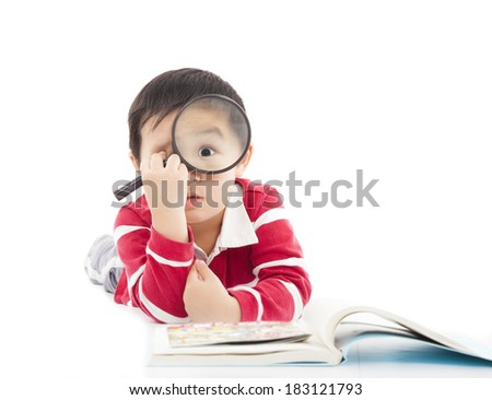 surprised kid is holding magnifying glass - stock photo