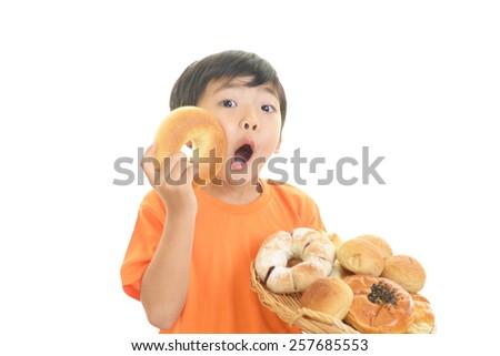 Surprised little Asian boy - stock photo