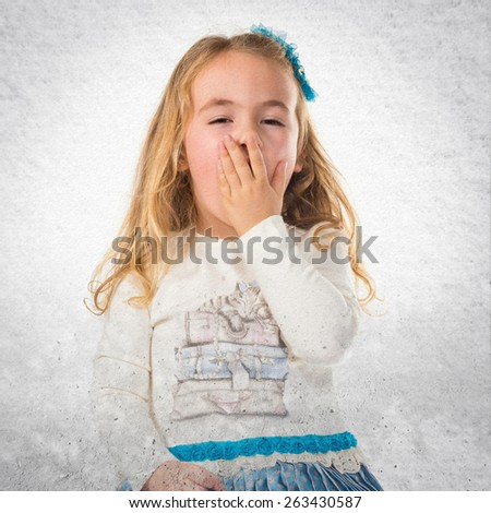 Surprised little blonde girl - stock photo