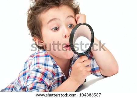 Surprised little boy with weird hair and magnifier isolated on white - stock photo