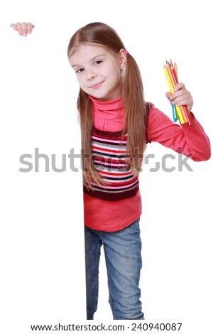 Surprised little girl holding colorful pencils with light blank/Emotion girl colorful pencils over white banner looking at camera - stock photo
