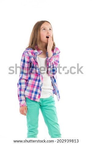 Surprised little girl. Surprised young girl in lumberjack shirt looking up. Three quarter length studio shot isolated on white. - stock photo