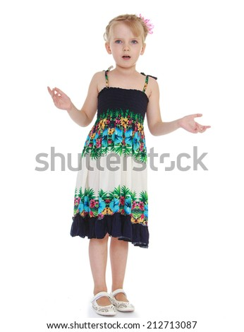 Surprised little girl throws up his hands on a white background.The concept of development of the child younger years. - stock photo