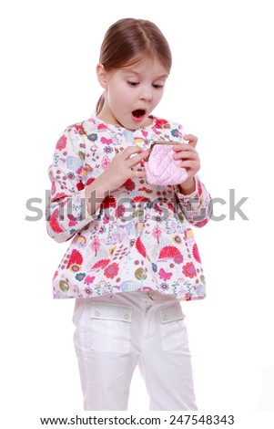 Surprised little girl with purse  - stock photo