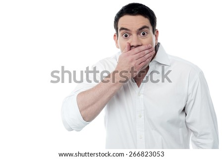 Surprised man covering his mouth with hand - stock photo