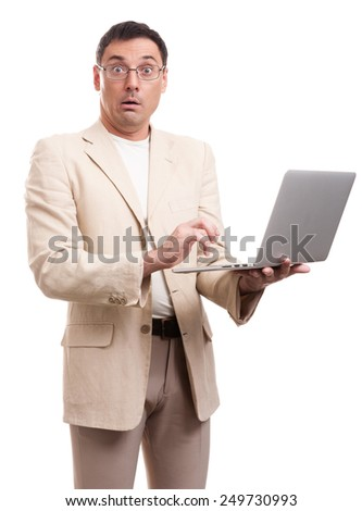 surprised man wearing suit and glasses with laptop. Isolated over white - stock photo