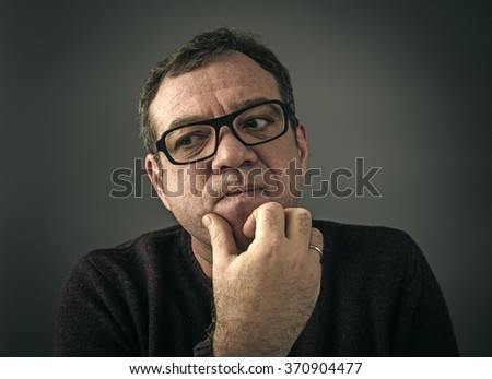 Surprised man with glasses. Low-key style photo - stock photo