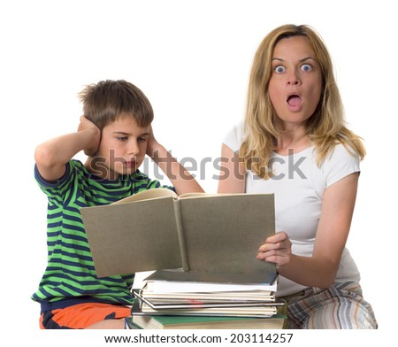 surprised  mother trying to teach her son while he is confronting  - stock photo