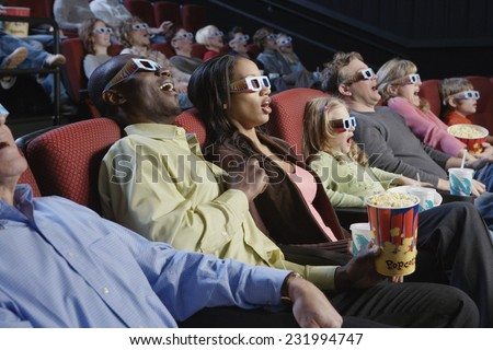 Surprised People Watching 3-Dimensional Movie - stock photo