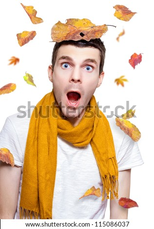 Surprised Person Wearing Scarf While Having Fun With A Tree Leaf On Head In A Season Depiction Of Fall On White Background - stock photo