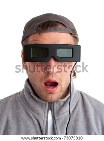 Surprised player with 3-D glasses. Isolated on white - stock photo