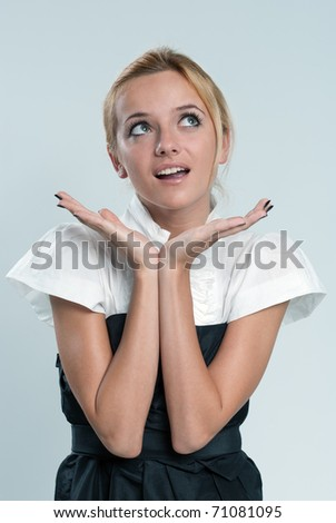 Surprised sexy blonde! Lady against grey background wearing fashionable dress studio shot. - stock photo