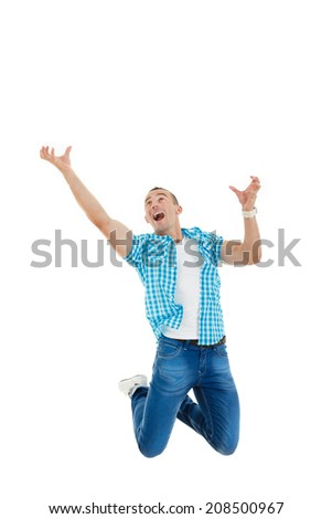 surprised smiling man jumps in the air with his hands up as if he trying to catches money from aobe or something - stock photo