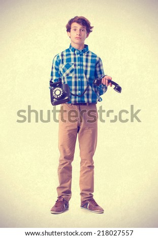surprised teenager holding a phone - stock photo