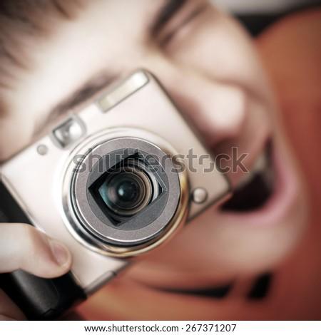 Surprised Teenager with Photo Camera closeup - stock photo