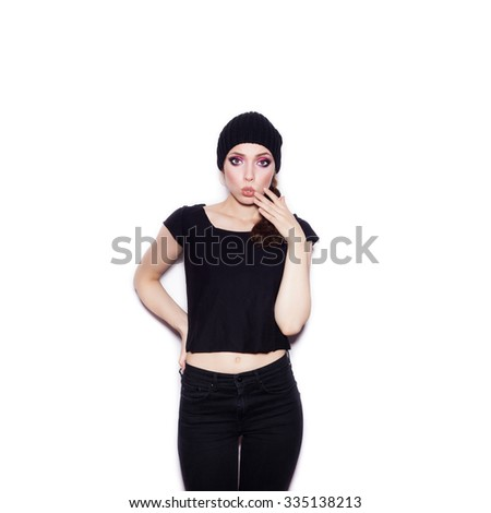 Surprised woman in black clothes having fun. Portrait of expressive girl on white background not isolated  - stock photo
