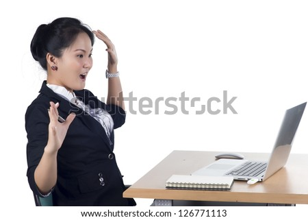Surprised woman looking in screen of laptop, Isolated white background. Model is Asian woman. - stock photo