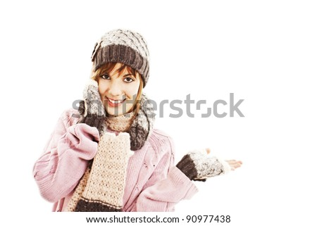 Surprised woman showing open hand palm with copy space for product or text. Winter style. - stock photo