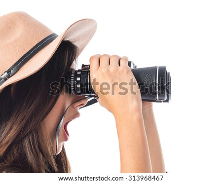 Surprised woman with binoculars  - stock photo