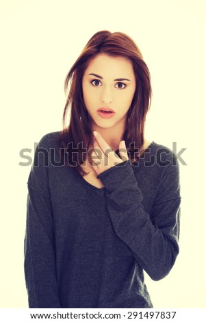 Surprised young beautiful brunette woman - stock photo