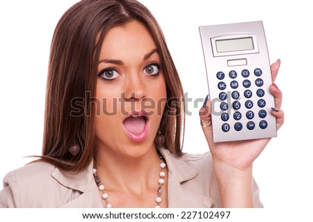 Surprised young business woman holding calculator - isolated on white - stock photo