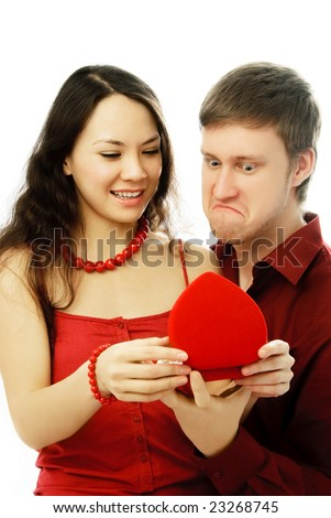 surprised young couple opening a present isolated against white background - stock photo