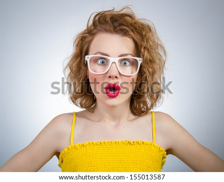 Surprised young funny woman, close-up portrait of a girl - stock photo
