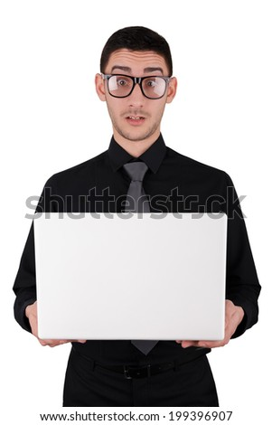 Surprised Young Man with Glasses Holding Laptop - Man with a funny expression on his face holds a white laptop isolated on white background  - stock photo