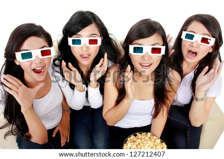 Surprised Young woman in 3D glasses and watching a movie - stock photo