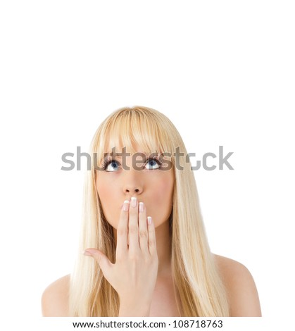 Surprised young woman looking up at copy space over white - stock photo