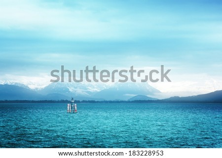 Surreal, dreamy view of Bodensee (Lake Constance) with the Alps in the background. - stock photo