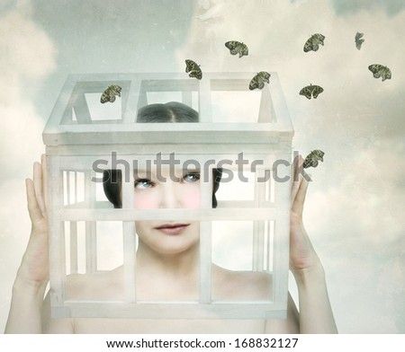Surreal girl with a small wooden and and glass little house in her head that looks the butterflies outside - stock photo