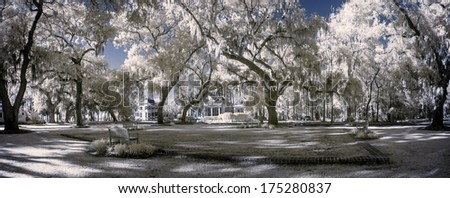 surreal infrared landscape with trees and park - stock photo
