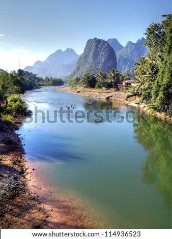 Surreal landscape by the Song river at Vang Vieng - stock photo