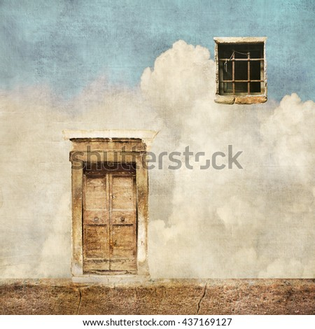 Surreal landscape with old door and window on cloudy sky - stock photo