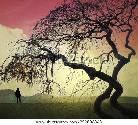 Surreal landscape with small human figure and twisted branches - stock photo