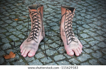 surreal photomontage of shoe and foot - stock photo