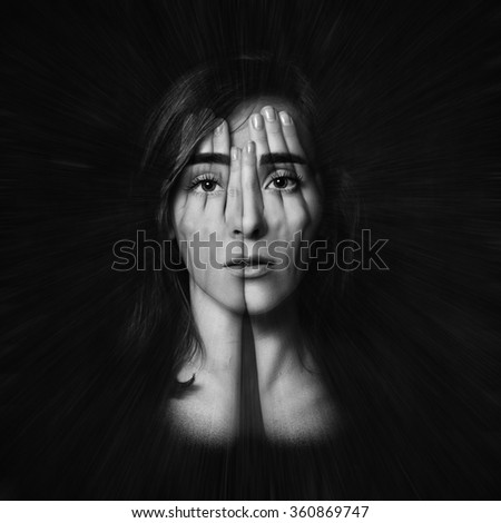 Surreal portrait of a young girl covering  her face and eyes with  her hands.Double exposure. Black and White. - stock photo