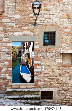 Surreal View of Canal  in Venice through the Window - stock photo