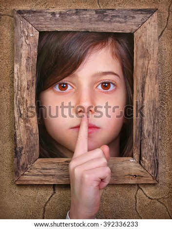 Surrealistic image of shushing girl in frame - stock photo