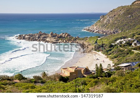 Surrounded by large granite boulders and overlooked by mountains, Llandudno Beach is one of the most beautiful beaches in Cape Town, South Africa. - stock photo