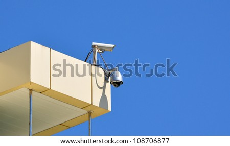 Surveillance cam and dome type camera on a top - stock photo