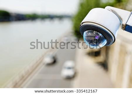 surveillance camera above a road - stock photo