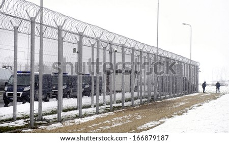 surveillance cameras on prison wall - stock photo
